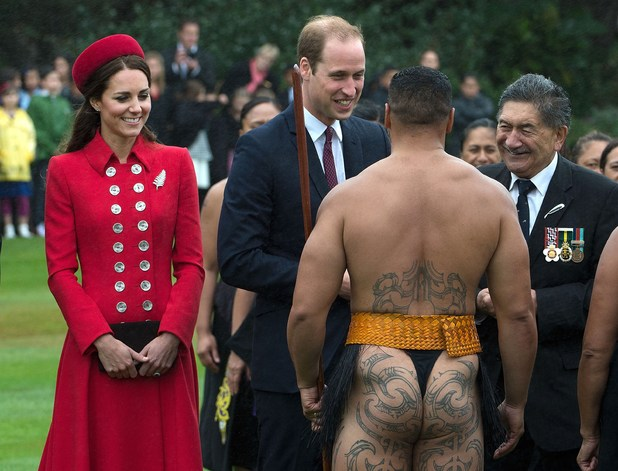 Caption:Britain's Prince William (C) and his wife Catherine (L) meet a Maori warrior during a welcoming ceremony at Government House in Wellington on April 7, 2014. Britain's Prince William, his wife Kate and their son Prince George are on a three-week tour of New Zealand and Australia. AFP PHOTO / MARTY MELVILLE (Photo credit should read Marty Melville/AFP/Getty Images)