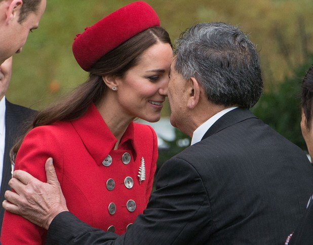 Catherine (L), the Duchess of Cambridge, receives a 'hongi', a traditional Maori greeting, by a Maori elder during a welcoming at Government House in Wellington on April 7, 2014. Britain's Prince William, Kate and their son Prince George are on a three-week tour of New Zealand and Australia. AFP PHOTO / MARTY MELVILLE (Photo credit should read Marty Melville/AFP/Getty Images)