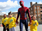 Garfield surprises kids as Spider-Man