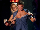 Efron shows off his abs after winning Best Shirtless Performance at MTV Awards.