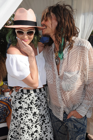 Caption:THERMAL, CA - APRIL 12: Singers Katy Perry (L) and Steven Tyler attend the LACOSTE Beautiful Desert Pool Party on April 12, 2014 in Thermal, California. (Photo by Angela Weiss/Getty Images)