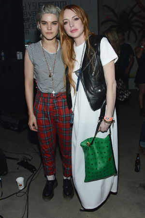 COACHELLA, CA - APRIL 12: Soko and Lindsay Lohan attend the FLAUNT Magazine & Siwy present Virgin Sacrifices event on April 12, 2014 in Coachella, California. (Photo by Araya Diaz/Getty Images for FLAUNT MAGAZINE)