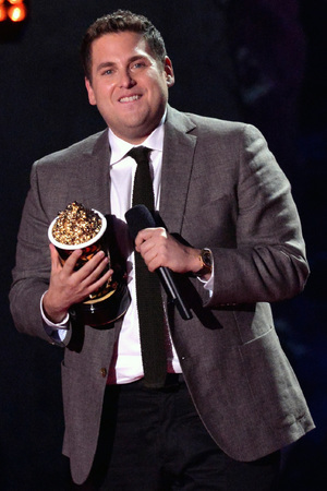 Jonah Hill speaks onstage at the 2014 MTV Movie Awards