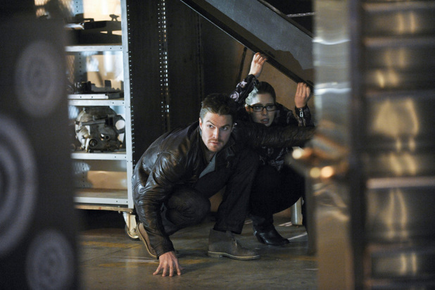 Stephen Amell as Oliver Queen and Emily Bett Rickards as Felicity Smoak in 'Arrow' S02E19: 'The Man Under The Hood'