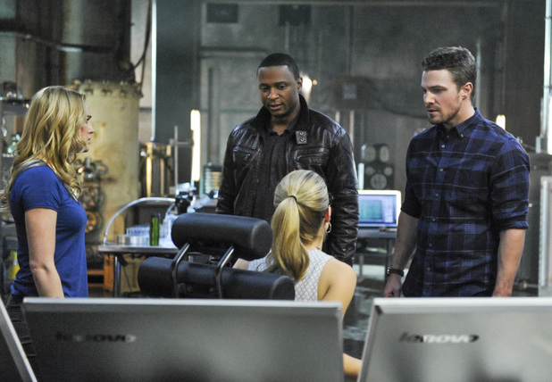 Caity Lotz as Sara Lance, David Ramsey as John Diggle, Emily Bett Rickards as Felicity Smoak and Stephen Amell as Oliver Queen in 'Arrow' S02E19: 'The Man Under The Hood'