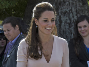 ADELAIDE, AUSTRALIA - APRIL 23: Catherine, Duchess of Cambridge arrives at the Playford Civic Centre in the Adelaide suburb of Elizabeth on April 23, 2014 in Adelaide, Australia. The Duke and Duchess of Cambridge are on a three-week tour of Australia and New Zealand, the first official trip overseas with their son, Prince George of Cambridge. (Photo by Arthur Edwards - Pool/Getty Images)