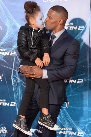NEW YORK, NY - APRIL 24: Actor Jamie Foxx (R) and his daughter Annalise attend 'The Amazing Spider-Man 2' premiere at the Ziegfeld Theater on April 24, 2014 in New York City. (Photo by Jamie McCarthy/Getty Images)