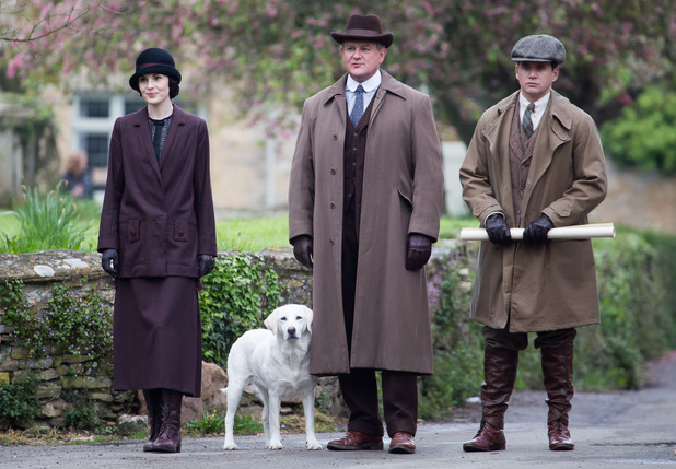 The cast of Downton Abbey film scenes on location outside a churchyard People: Michelle Dockery, Allen Leech, Hugh Bonneville