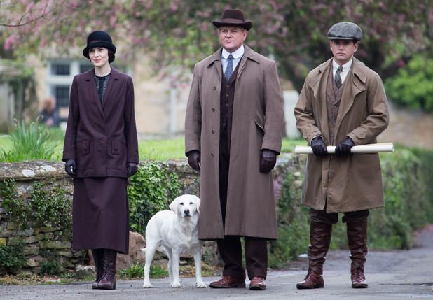 The cast of Downton Abbey film scenes on location outside a churchyard People: Michelle Dockery, Allen Leech, Hugh Bonneville