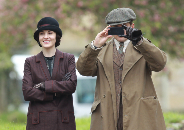 The cast of Downton Abbey film scenes on location outside a churchyard People: Michelle Dockery, Allen Leech