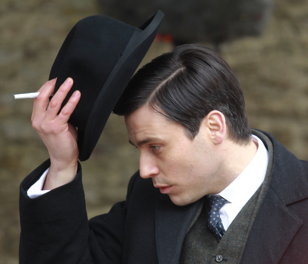The cast of Downton Abbey film scenes on location outside a churchyard Rob James-Collier