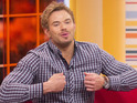 Ex-Twilight actor looks ready to burst out of his clothes in breakfast TV interview.