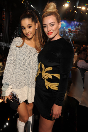 LOS ANGELES, CA - MAY 01: Singer Ariana Grande (L) and actress Hilary Duff in the audience at the 2014 iHeartRadio Music Awards held at The Shrine Auditorium on May 1, 2014 in Los Angeles, California. iHeartRadio Music Awards are being broadcast live on NBC. (Photo by Kevin Mazur/Getty Images for Clear Channel)