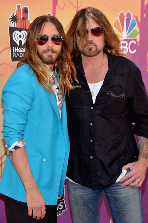 LOS ANGELES, CA - MAY 01: iHEARTRADIO MUSIC AWARDS -- Pictured: (l-r) Actor/recording artist Jared Leto of music group 30 Seconds to Mars and Billy Ray Cyrus arrive at the iHeartRadio Music Awards held at the Shrine Auditorium on May 1, 2014. (Photo by Michael Buckner/NBC/NBCU Photo Bank)