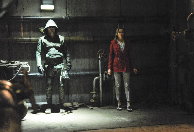 Katie Cassidy as Laurel Lance, Mirakuru Soldier, and Stephen Amell as The Arrow in Arrow S02E21: 'City of Blood'
