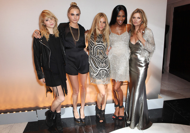 LONDON, ENGLAND - APRIL 29: (L to R) Suki Waterhouse, Cara Delevingne, Sienna Miller, Naomi Campbell and Kate Moss attend a private dinner celebrating the Global Launch of the 'Kate Moss for TopShop Collection' at The Connaught Hotel on April 29, 2014 in London, England. (Photo by David M. Benett/Getty Images)