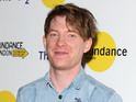"Domhnall Gleeson jokes that he gets ""sick in the mouth"" discussing Star Wars."