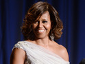 Michelle Obama announces that the public can now take photos and use social media.