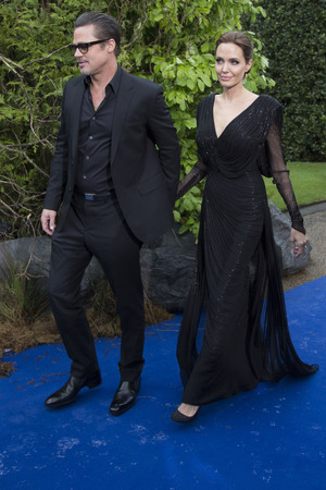 LONDON, UNITED KINGDOM - MAY 08: Brad Pitt and Angelina Jolie attend a private reception as costumes and props from Disney's 'Maleficent' are exhibited in support of Great Ormond Street Hospital at Kensington Palace on May 8, 2014 in London, England. (Photo by Julian Parker/UK Press via Getty Images)