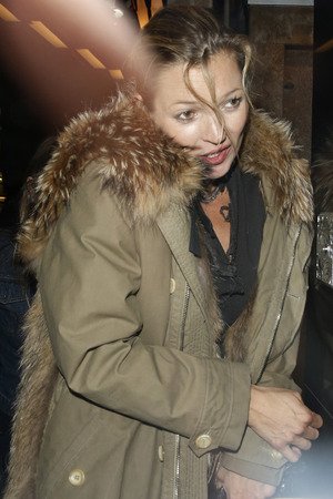 LONDON, UNITED KINGDOM - MAY 08: Kate Moss seen leaving Mert + Marcus & Miley Cyrus party held at Madame JoJo?s on May 8, 2014 in London, England. (Photo by William A Parker/GC Images)