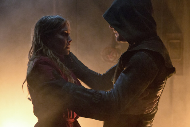 Katie Cassidy as Laurel Lance and Stephen Amell as The Arrow in Arrow S02E22: 'Streets of Fire'
