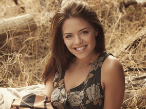 Olympia Valance plays Paige Novak