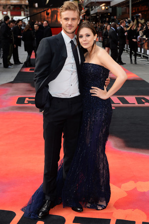 LONDON, ENGLAND - MAY 11: Elizabeth Olsen and Boyd Holbrook attend the European premiere of 'Godzilla' at the Odeon Leicester Square on May 11, 2014 in London, England. (Photo by Dave J Hogan/Getty Images)