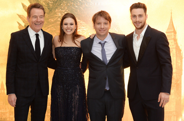 LONDON, ENGLAND - MAY 11: (L-R) Bryan Cranston, Elizabeth Olsen, Gareth Edwards and Aaron Taylor Johnson attend the European premiere of 'Godzilla' at the Odeon Leicester Square on May 11, 2014 in London, England. (Photo by Dave J Hogan/Getty Images)