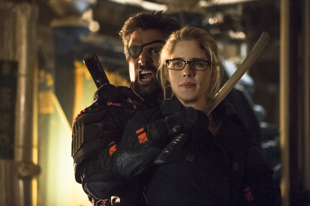 Manu Bennett as Slade Wilson and Emily Bett Rickards as Felicity Smoak in Arrow S02E23: 'Unthinkable'
