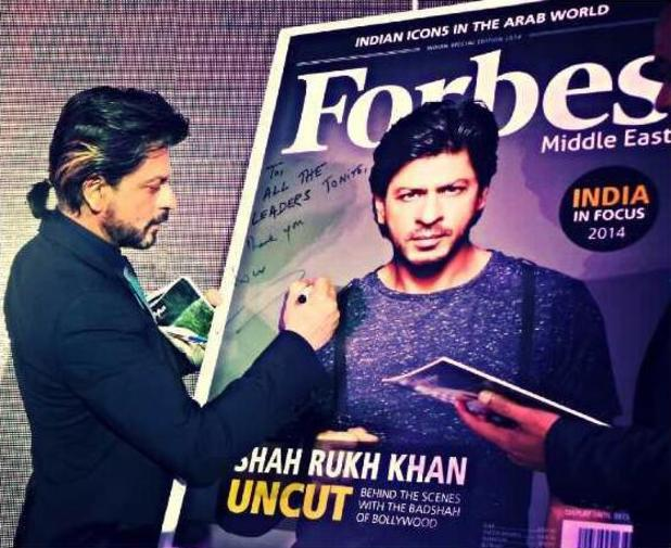Shah Rukh Khan appears next to his cover of Forbes Middle East