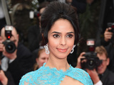 Mallika Sherawat attends the Opening Ceremony and the 'Grace of Monaco' premiere during the 67th Annual Cannes Film Festival on May 14, 2014 in Cannes, France.