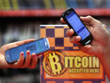 Tech trader is first retailer with major high-street presence to accept Bitcoin.