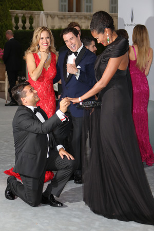amfAR Cinema Against Aids 2013 Gala, 67th Cannes Film Festival, France - 22 May 2014 Kelly Preston and John Travolta watch a marriage proposal 22 May 2014
