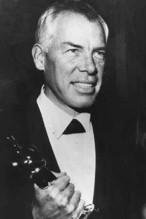 American actor Lee Marvin (1924 - ) with Michelle Triola, holding the Academy Award Oscar for best actor which he won for the film 'Cat Ballou'. Original Publication: People Disc - HH0321 (Photo by Keystone/Getty Images)
