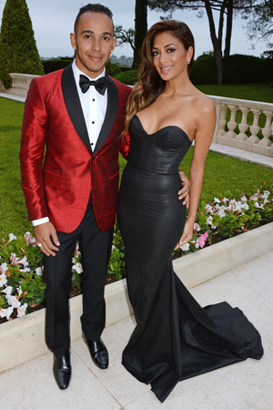 CAP D'ANTIBES, FRANCE - MAY 22: Lewis Hamilton (L) and Nicole Scherzinger attend amfAR's 21st Cinema Against AIDS Gala presented by WORLDVIEW, BOLD FILMS, and BVLGARI at Hotel du Cap-Eden-Roc on May 22, 2014 in Cap d'Antibes, France. (Photo by Dave M. Benett/amfAR14/WireImage)