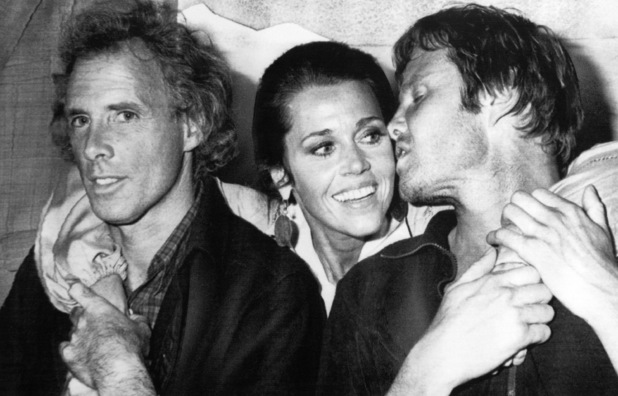 "CANNES, May 26, 1978-Actor Jon Voight , right , turns to kiss Jane Fonda May 26, 1978 as they pose with Bruce Dern, left. The three were at the 31st International Film Festival at Cannes for the screening of the us film ""Coming Home"" in which they star. (AP Photo/Jean Jacques Levy)"