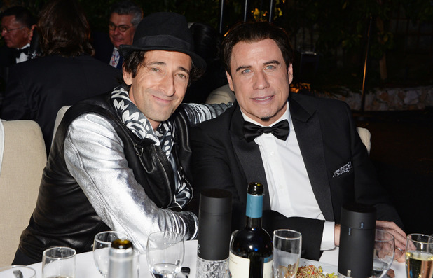 CANNES, FRANCE - MAY 21: (ITALY-OUT) Adrien Brody (L) and John Travolta attend the welcome party for Puerto Azul Experience Night at Villa St George on May 21, 2014 in Cannes, France. (Photo by David M. Benett/Getty Images for Puerto Azul)