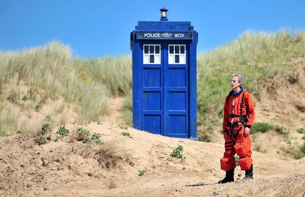 Doctor Who' TV series filming, Aberavon beach, Port Talbot, Wales, Britain - 21 May 2014 Peter Capaldi and Jenna-Louise Coleman in orange space-suits next to the Tardis 21 May 2014
