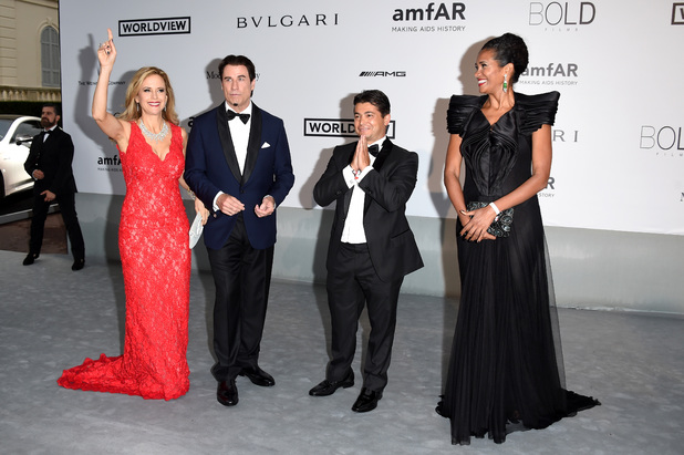 CAP D'ANTIBES, FRANCE - MAY 22: Kelly Preston, John Travolta, Oscar Generale and Danny Mendez attend amfAR's 21st Cinema Against AIDS Gala Presented By WORLDVIEW, BOLD FILMS, And BVLGARI at Hotel du Cap-Eden-Roc on May 22, 2014 in Cap d'Antibes, France. (Photo by Venturelli/WireImage)