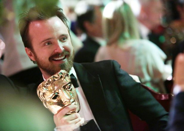 Aaron Paul with his award at the BAFTA after party