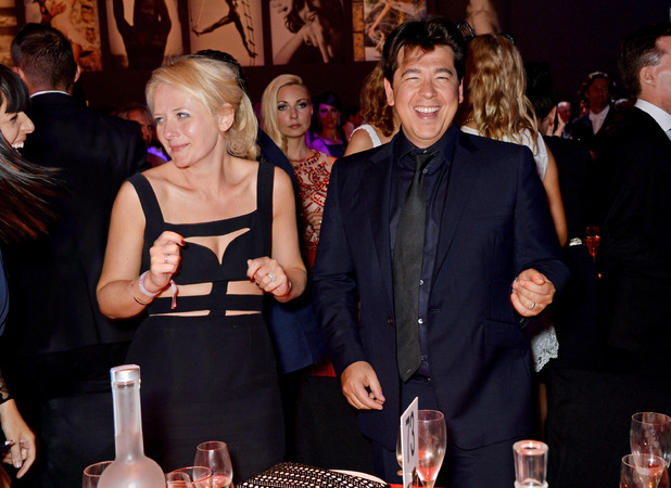 CAP D'ANTIBES, FRANCE - MAY 22: Kitty McIntyre (L) and Michael McIntyre attend amfAR's 21st Cinema Against AIDS Gala presented by WORLDVIEW, BOLD FILMS, and BVLGARI at Hotel du Cap-Eden-Roc on May 22, 2014 in Cap d'Antibes, France. (Photo by Dave M. Benett/amfAR14/WireImage)