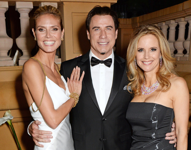 CANNES, FRANCE - MAY 21: (ITALY-OUT) (L to R) Heidi Klum, John Travolta and Kelly Preston attend the welcome party for Puerto Azul Experience Night at Villa St George on May 21, 2014 in Cannes, France. (Photo by David M. Benett/Getty Images for Puerto Azul)