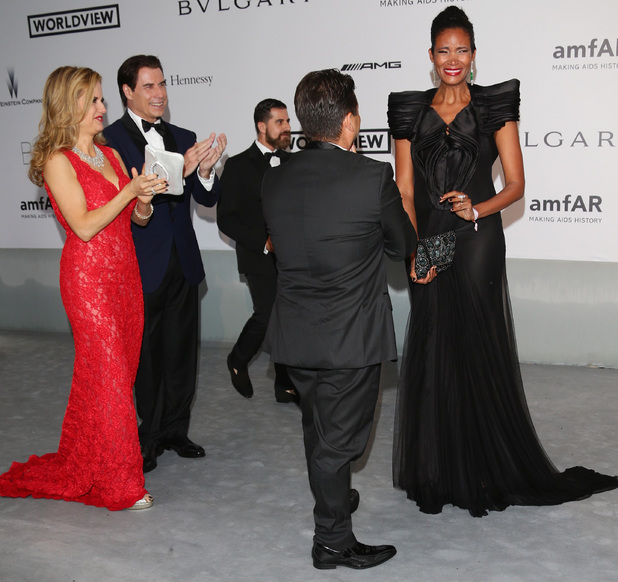 CAP D'ANTIBES, FRANCE - MAY 22: John Travolta, Kelly Preston, Oscar Generale and Danny Mendez attend amfAR's 21st Cinema Against AIDS Gala Presented By WORLDVIEW, BOLD FILMS, And BVLGARI at Hotel du Cap-Eden-Roc on May 22, 2014 in Cap d'Antibes, France. (Photo by Vittorio Zunino Celotto/Getty Images)
