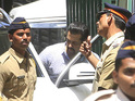 A court appearance in Jodhpur sees Khan sport a leather aviator jacket and sunglasses.