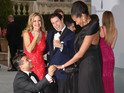 The Hollywood couple look on as film producer Oscar Generale gets down on one knee.