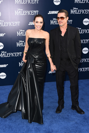 HOLLYWOOD, CA - MAY 28: Actors Angelina Jolie and Brad Pitt attend the World Premiere of Disney's 'Maleficent' at the El Capitan Theatre on May 28, 2014 in Hollywood, California. (Photo by Jason Merritt/Getty Images)