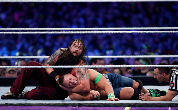 John Cena and Bray Wyatt compete during Wrestlemania XXX at the Mercedes-Benz Super Dome