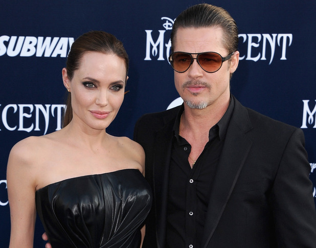 Angelina Jolie and Brad Pitt attend the World Premiere Of Disney's 'Maleficent'