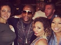 Boxer Floyd Mayweather Jr and rapper TI reportedly fight at a Fat Burger on the Las Vegas strip.