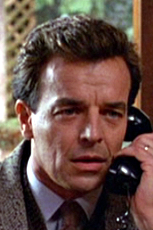 Ray Wise In 'Twin Peaks' Caption:American actor Ray Wise (as Leland Palmer) speaks on a telephone in a scene from the pilot episode of the television series 'Twin Peaks,' originally broadcast on April 8, 1990. (Photo by CBS Photo Archive/Getty Images)